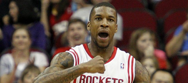 Houston Rockets power forward Thomas Robinson (41) pumps his fist after scoring against the Cleveland Cavaliers during the first half of an NBA basketball game, Friday, March 22, 2013, in Houston.