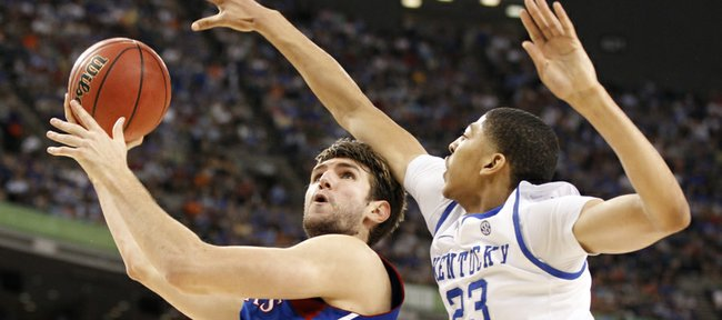 Kansas center Jeff Withey looks for a shot as Kentucky forward Anthony Davis reaches in to defend during the first half of the national championship on Monday, April 2, 2012 in New Orleans.