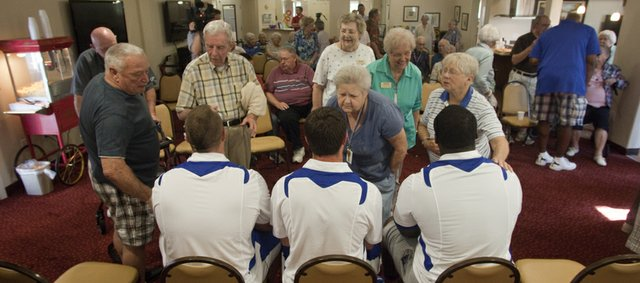 Three Kansas University football players were on hand at the Meadowlark Estates Retirement Home on Wednesday, July 10, 2013, to discuss the upcoming season with residents.