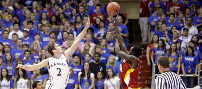 Kansas guard Conner Teahan lunges to defend a shot by Pittsburg State forward Arjok Guguai during the first half Tuesday, Nov. 1, 2011 at Allen Fieldhouse.