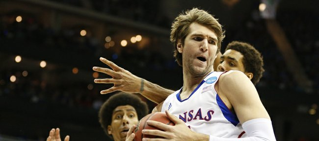 Kansas center Jeff Withey pulls a rebound from North Carolina forward James Michael McAdoo during the first half, Sunday, March 24, 2013 at the Sprint Center in Kansas City, Mo. In back is Kansas forward Kevin Young.