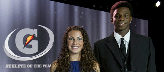 In a photo provided by Gatorade, Andrew Wiggins, right, and Morgan Andrews hold their trophies after being named the nation's top prep male and female athletes, Tuesday, July 16, 2013, in Los Angeles.