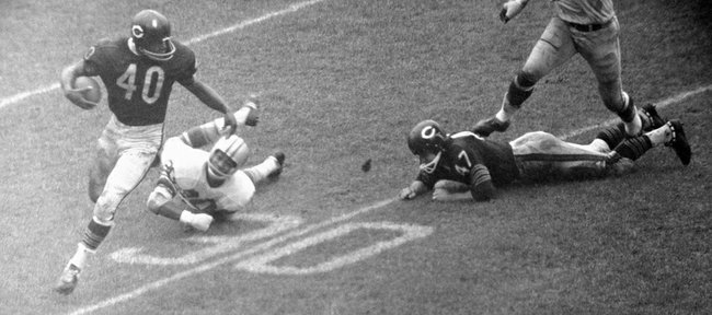 Chicago Bears running back Gale Sayers breaks free of a Detroit Lions defender during a game Oct. 15, 1967.