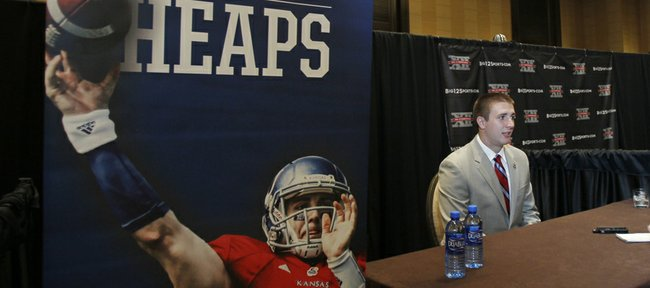 Kansas quarterback Jake Heaps conducts interviews during a breakout session at the Big 12 Conference Football Media Days Monday, July 22, 2013 in Dallas.