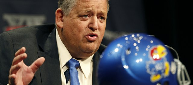 Kansas football coach Charlie Weis answers questions from the media during the Big 12 Conference Football Media Days Monday, July 22, 2013 in Dallas.