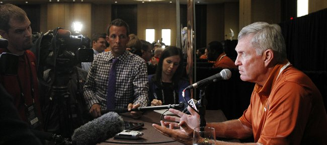 Texas coach Mack Brown talks to members of the media during a breakout session at the Big 12 Conference football media days on Tuesday, July 23, 2013, in Dallas.