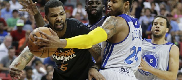 Golden State Warriors guard Kent Bazemore (20) deflects a pass by Phoenix Suns Marcus Morris in the fourth quarter of the NBA Summer League championship game, Monday, July 22, 2013, in Las Vegas. The Warriors won 91-77.
