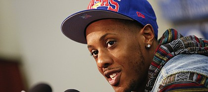Kansas great Mario Chalmers talks with media members prior to tipoff against Texas on Saturday, Feb. 16, 2013 at Allen Fieldhouse.