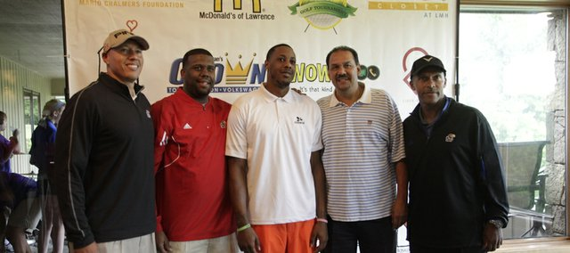 Mario Chalmers, center, poses with Kansas assistant coaches Jerrance Howard, second from left, Kurtis Townsend, second from right, and Norm Roberts, right, prior to Chalmers' charity golf tournament on Monday, July 29, 2013, at Alvamar.