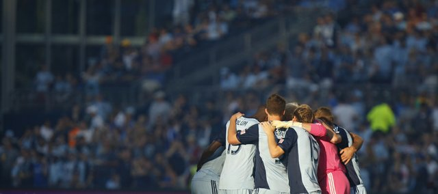 Sporting Kansas City huddles before the start of the first half during the MLS game between the Columbus Crew and Sporting Kansas City at Sporting Park in Kansas City, Kan.