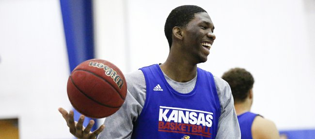 Kansas center Joel Embiid laughs during warmups before a scrimmage on Wednesday, June 12, 2013 at the Horejsi Center.