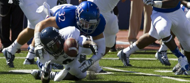 Kansas' Schyler Miles (32) forces Rice's Donte Moore to fumble the kickoff return during their game Saturday, Sept. 8, 2012 at Memorial Stadium.