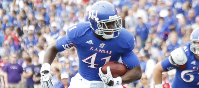 Kansas tight end Jimmay Mundine (41) makes a grab near the goal line during Kansas' game against TCU Saturday, Sept. 15, 2012 at Memorial Stadium.