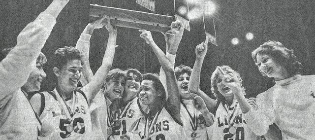 Members of the 1984 Lawrence High girls basketball team raise their Class 6A state championship trophy after beating Derby, 49-48, on March 10, 1984, at Allen Fieldhouse. The Lions, from left, are Jenny Clark, Claire Masinton, Dorinda Kearns, Amy Lienhard, Nikki Wright, Betsy Brand, Jodi Oelschlager and Mary Kay Waller. The championship team was inducted into the Kansas Basketball Coaches Association's Hall of Fame on Wednesday, Aug. 7, 2013, in Topeka.