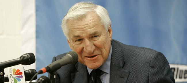 This Dec. 8, 2006 file photo shows former North Carolina basketball coach Dean Smith speaking during a news conference in Chapel Hill, N.C. President Barack Obama will bestow the nation's highest civilian honor, the Presidential Medal of Freedom, on Smith and several others later this year.