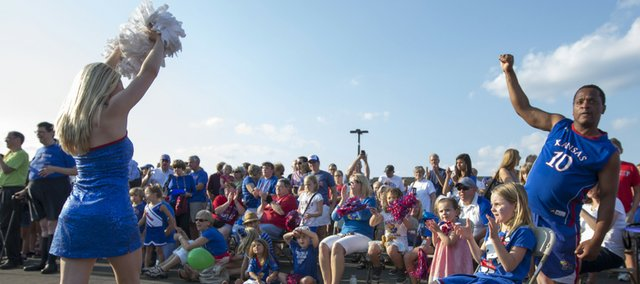 The Kansas University Rock Chalk Dancers get the crowd fired up during the annual football kickoff pep rally, held at Corinth Square in Prairie Village on Friday.