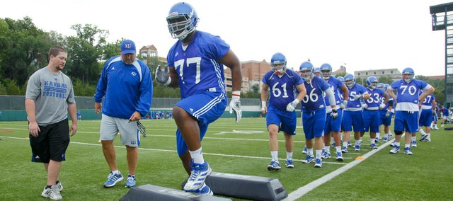Kansas offensive lineman Aslam Sterling (77) runs through a conditioning drill with the rest of the line during practice on Friday, Aug. 9, 2013. Nick Krug/Journal-World Photo