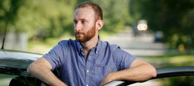About three years ago, Lawrence resident Josh Reese and his then 5-month-old daughter, Greer, were victims of a texting-while-driving accident on Kansas Highway 32. Reese, whose car was totalled when another driver crossed the median, says he is still amazed that he and his daughter came away from the accident unharmed.