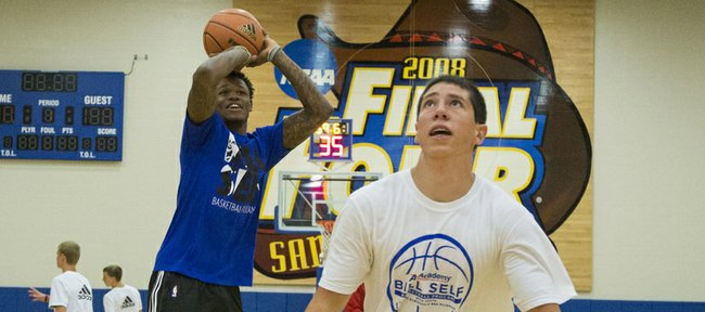 Former Kansas University player Ben McLemore eliminates Dakota Marriott, 17, Smithville, Mo., during game of knockout as other campers watch during the Bill Self basketball camp Saturday.