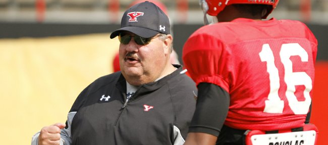 "Former Kansas University coach Mark Mangino says he's ""having more fun right now than I've had in a long, long time in coaching"" during his first few months at Youngstown State, his alma mater. Mangino, seen here at YSU practice on Aug. 13, 2013, in Youngstown, Ohio, is the Penguins' assistant head coach, tight ends coach and recruiting coordinator."