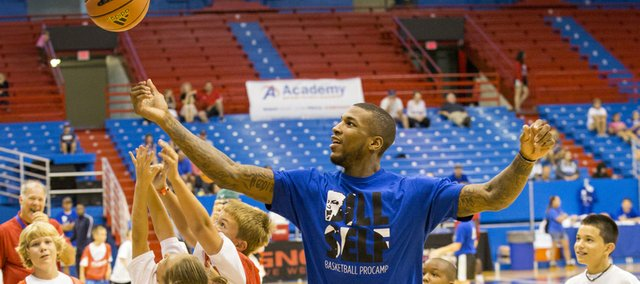 Former Kansas University forward Thomas Robinson, a current member of the NBA's Portland Trail Blazers, goes after a rebound during the Bill Self basketball camp held Sunday, Aug. 18, 2013, at Allen Fieldhouse.