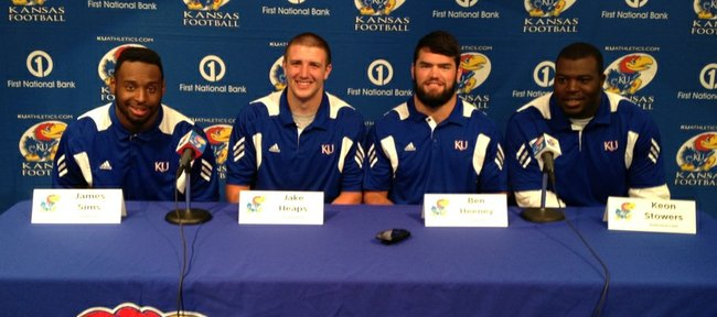 The Kansas University football team announced its 2013 captains — from left, senior running back James Sims, junior quarterback Jake Heaps, junior linebacker Ben Heeney and junior defensive tackle Keon Stowers — on Monda