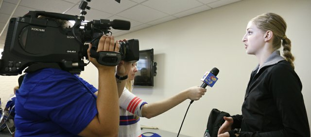 Kansas senior volleyball player Caroline Jarmoc is interviewed by members of the KU Athletics staff during a fall sports media day on Wednesday, Aug. 21, 2013, at Allen Fieldhouse.