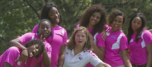 Kansas women's basketball coach Bonnie Henrickson, center, strikes a pose with members of her team during Henrickson's annual golf tournament on Saturday at the Alvamar golf courses. All proceeds from the tournament benefit the women's basketball program and the Lawrence Memorial Hospital Breast Center.