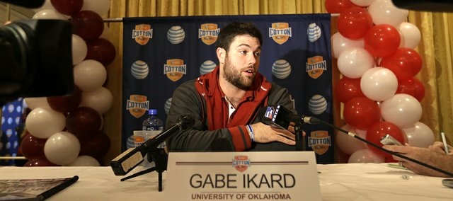 Oklahoma's Gabe Ikard responds to questions during a Cotton Bowl football press conference Monday, Dec. 31, 2012, in Irving, Texas.