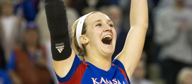 Kansas' Brianne Riley raises her hands in celebration following Kansas' victory over Big 12 conference foe West Virginia, Monday, Oct. 29, 2012 at the Horejsi Center. The Jayhawks defeated the Mountaineers 3-0 and improved their overall record to 20-4.