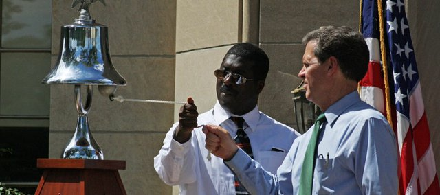 "The Rev. Gordon Glenn, left, and Kansas Gov. Sam Brownback ring a bell during a commemoration of Martin Luther King Jr.'s ""I Have a Dream"" speech, Wednesday, August 28, 2013, in Topeka, Kansas. Brownback led a ceremony at the Brown v. Board of Education National Historic Site to commemorate the 50th anniversary of King's speech during the 1963 March on Washington. (AP Photo/John Milburn)"