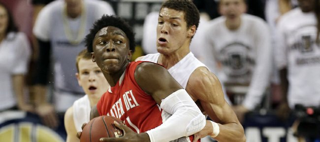 Mater Dei forward Stanley Johnson, left, spins around Archbishop Mitty forward Aaron Gordon as he goes to the basket during the second quarter of the CIF boys open division state high school basketball championship game in Sacramento, Calif., Saturday, March 23, 2013.