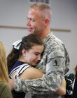 "Bishop Seabury Academy sophomore Aleena Plotnikov gives a tearful hug to biology teacher Christopher Bryan during a school assembly to bid farewell to Bryan, who is being deployed to Afghanistan to serve as a chaplain. ""He's just always there for us and he always has time to talk to us whenever we need him,"" Aleena said of Bryan."
