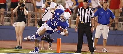 Kansas running back Brandon Bourbon falls into the endzone for a touchdown against South Dakota during the fourth quarter on Saturday, Sept. 7, 2013 at Memorial Stadium.