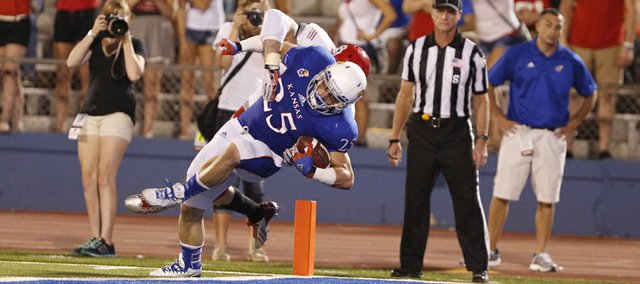 Kansas running back Brandon Bourbon falls into the endzone for a touchdown against South Dakota during the fourth quarter on Saturday, Sept. 7, 2013 at Memorial Stadium.