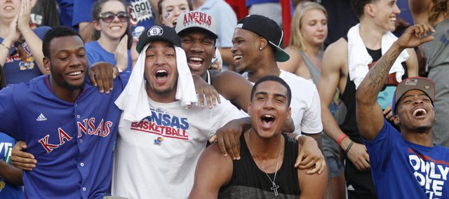 Members of the KU men's basketball team celebrate a KU score in KU's season opening win against South Dakota at Memorial Stadium, Saturday, Sept. 7, 2013. From left are Naadir Tharpe, Niko Roberts, Wayne Selden, former player Ben McLemore, Landen Lucas, Christian Garrett, background and Frank Mason.