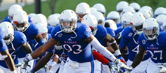 Kansas buck Ben Goodman (93) leads the Jayhawks onto the field against South Dakota on Saturday, Sept. 7, 2013 at Memorial Stadium.