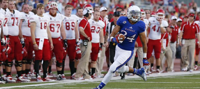 Kansas University punt returner Connor Embree heads up the sideline near the South Dakota bench during a return in the second quarter on Saturday, Sept. 7, 2013, at Memorial Stadium. KU coach Charlie Weis thinks Embree, a former walk-on in his first scholarship season with the Jayhawks, can be one of the best returners in the Big 12 Conference this year.
