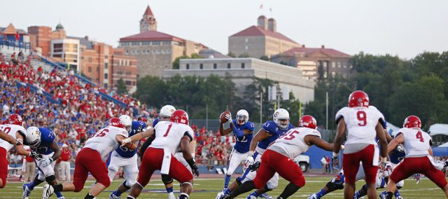 Kansas receiver Christian Matthews takes the snap in the wildcat formation deep in South Dakota territory during the second quarter on Saturday, Sept. 7, 2013 at Memorial Stadium.