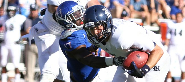 Kansas linebacker Tunde Bakare drags down Rice quarterback Taylor McHargue during the third quarter on Saturday, Sept. 8, 2012 at Memorial Stadium.
