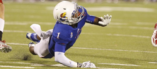 Kansas receiver Rod Coleman watches a pa
