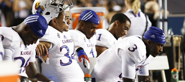 Kansas running back Tony Pierson (3) stews on the bench with some of the other running backs and receivers after a deep pass to him was ruled incomplete late in the fourth quarter against Rice on Saturday, Sept. 14, 2013 at Rice Stadium in Houston, Texas.