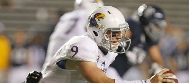 Kansas quarterback Jake Heaps is sacked on the final possession by Rice defensive tackle Christian Covington on Saturday, Sept. 14, 2013 at Rice Stadium in Houston, Texas.
