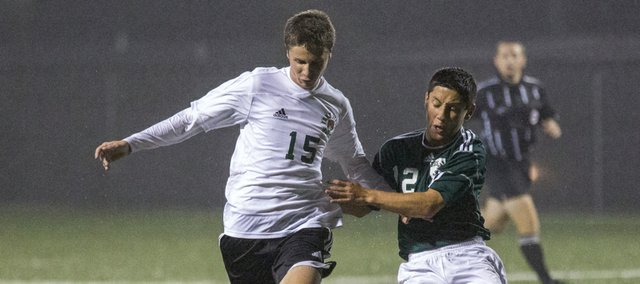 Free State forward AJ Ware (15) and De Soto's Arturo Sanchez (12) chase down the ball during their soccer match Monday, Sept. 16, 2013, at FSHS.