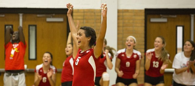 Lawrence High senior Caitlin Broadwell (5) celebrates a point as the LHS bench cheers during LHS' volleyball match against crosstown rival Free State Thursday at LHS.