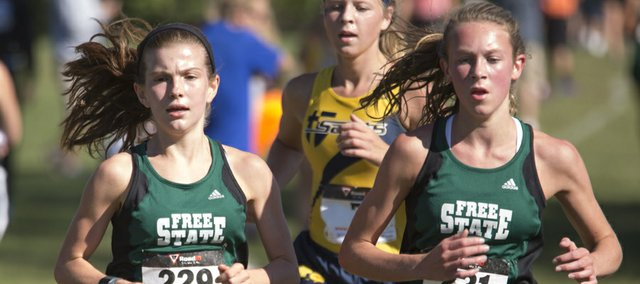 Free State's Claire Sanner, left, and Emily Venters set the pace during the girls 4K race at the  Baldwin Invitational Saturday morning in Baldwin City.