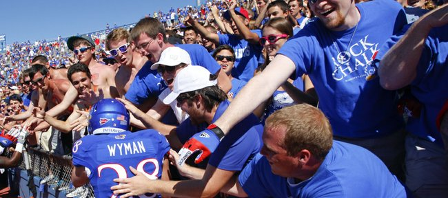 Kansas kicker Matthew Wyman is mobbed by the Kansas student section after his walk-off 52-yard fieldgoal gave the Jayhawks the win over Louisiana Tech on Saturday, Sept. 21, 2013 at Memorial Stadium.
