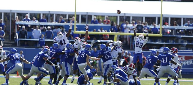 Kansas kicker Matthew Wyman watches his 52-yard field goal sail toward the uprights for a 13-10 win over Louisiana Tech during the on Saturday, Sept. 21, 2013 at Memorial Stadium.