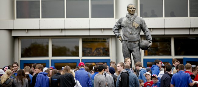 "The F.C. ""Phog"" Allen statue looms over fans waiting to enter the fieldhouse for Late Night in the Phog on Friday, Oct. 12, 2012 at Allen Fieldhouse."