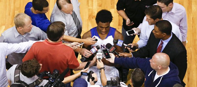 Media members crowd around the highly-touted Kansas freshman, Andrew Wiggins during Media Day on Wednesday, Sept. 25, 2013 at Allen Fieldhouse. Nick Krug/Journal-World Photo